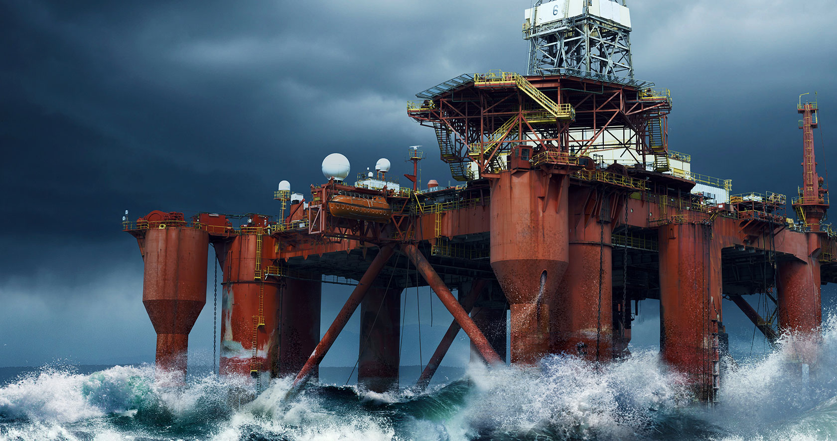 An offshore rig in stormy seas.